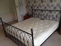 Wrought iron Super king bed frame with/without mattress. Structurally sound- few signs of wear.