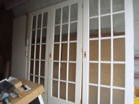 3 x multi paned white painted internal wooden doors. Will sell separately at £ 18 each.