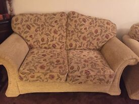 3 piece suite (3, 2, & 1 seater). Light gold fabric with floral design. Good condition.