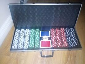 Set of 500 chips in silver carry case. With 2 decks of playing cards & dealer chip. Like brand new