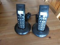 BT 1100 Graphite Handsets with Charging cradles.