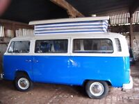 T2 BAY WINDOW POP TOP nearing completion and a number of VW T25 's for sale .