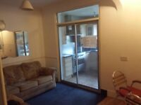 Large double (loft) room in shared house. 1 week deposit. All bills included. House with living room