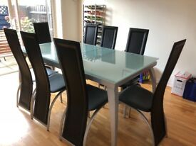 Glass Dining Table and 8 Leather Dining Chairs