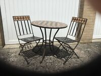 Bistro style outdoor table and two matching chairs