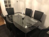 Glass dining table & 6 black real leather chairs