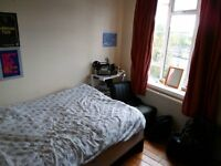 Single room with double bed available in a friendly and clean 5th floor flat close to Triangle.