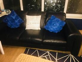 2 Black Leather Settees and Black / Grey Cuddle Chair
