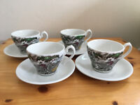 4 vintage cups depicting a hunting scene with 4 plain white saucers. £5 ovno the lot.