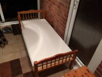 Junior bed with protected mattress