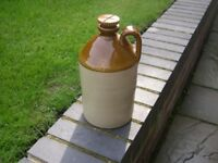 An attractive stoneware jar with screw stopper.