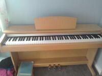 Yamaha Arius 141 digital piano as new condition.