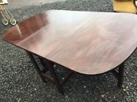 Beautiful victorian drop leaf dining table with brass castor wheels