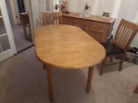 small oak extending dining table with 4 chairs in great condition for sale