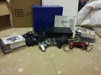 Sony PlayStation 2 with 3 controllers and 12 games