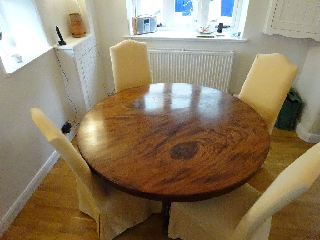 Pedestal tilt top round dining table; believed to be Georgian