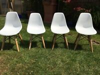 4 kids reproduction Eames chairs retro mid century