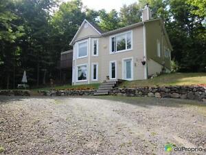 279 900$ - Maison à un étage et demi à vendre à St-Sauveur