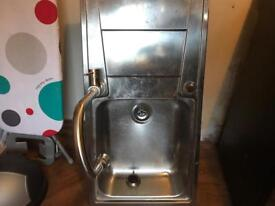 Kitchen sink with Taps with pop up plug.