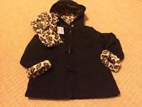 Brand new black coat age 3-4