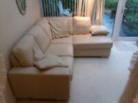 Cream leather L shaped settee.