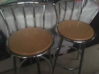 Wood and chrome bar stools in very good condition