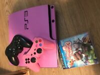 Pink ps3 with 2 controllers and game