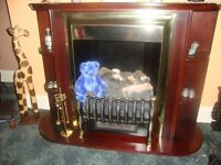 mahogany fire surround with inner working fire