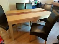 large dining table and 5 faux leather chairs