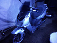 *** Aprilia SportCity 125** 1 Year UK MOT* spanish reg.* UK legal avoid any penalty* 1 owner