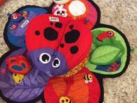 Lamaze tummy time mat and Redkite playmat