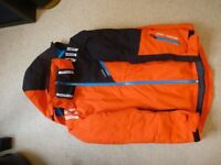 As new ski/snowboard jacket and salopettes (boy or girl 12-14 ages typical)