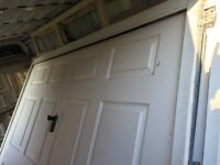 2 white garage doors