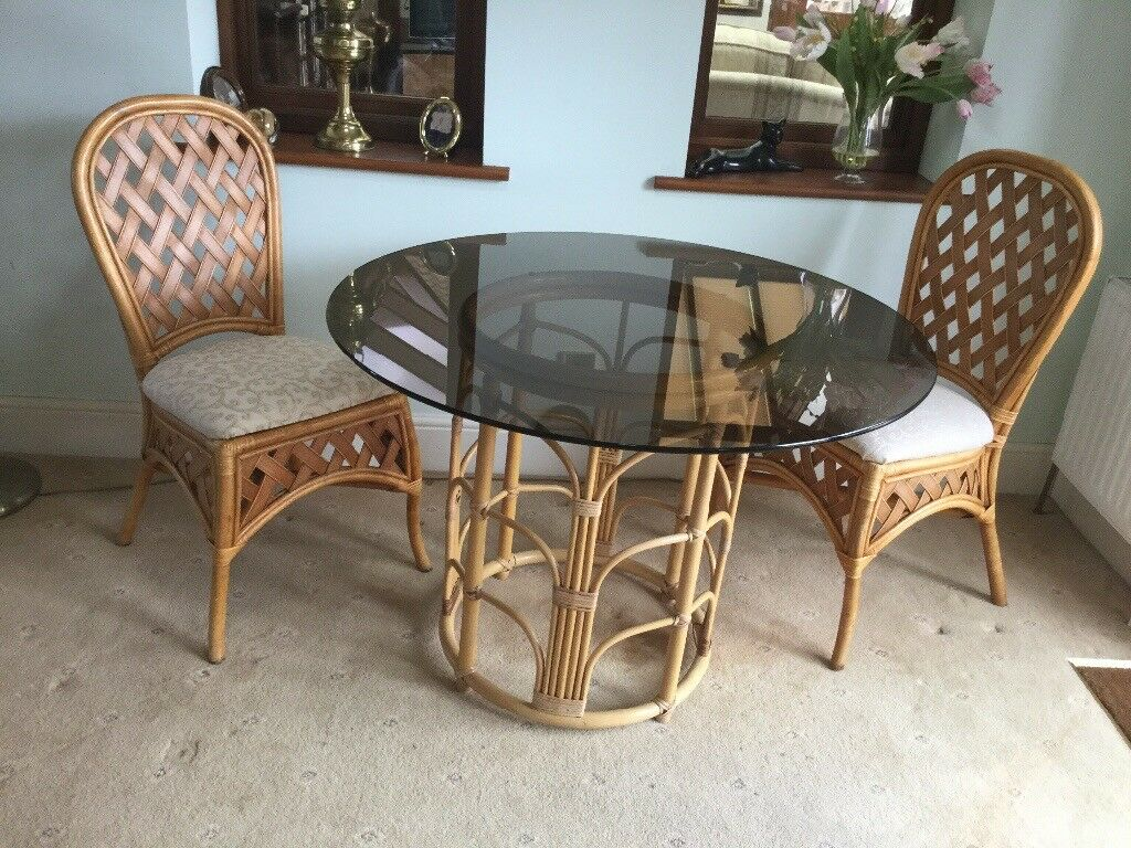Round Glass Top Cane Base Table And Two Chairs