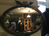 Antique Heavy Metal Framed Oval Bevel Edge Wall Mirror with Ornate Ribbon & Torch Trophy Crest