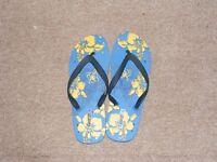 size 9/10 flip flops BRAND NEW .