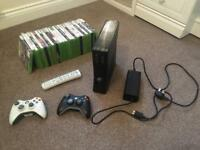 Xbox 360 Slim with two controllers and games