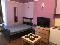 Spacious room with kitchen. All bills included. Sofa and fridge in the room