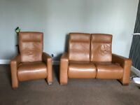 Himolla 2 seater leather sofa and chair....all seats recline and are extremely comfortable