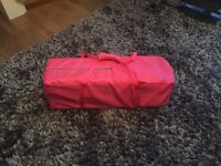 Pink travel cot for sale.