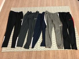 FIVE PAIRS OF MEN'S TRAINING TROUSERS / PANTS / TRACKSUIT BOTTOMS INCLUDING 3 x NIKE & 2 x SONDICO