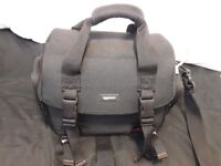 Large DSLR camera carrying case with grey interior and in messenger style