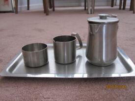 Tray, tea pot, milk just, sugar bowl