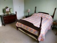 STAG double bed frame and chest of drawers.