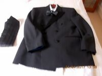 Complete double breasted dinner suit in black, suit , shirt, bow tie,, camiband,