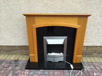 Oak fire surround with black marble inlay, hearth and electric flame effect fire