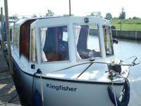 River cruiser boat narrow beam forward steer GRP idyllic mooring near Cambridge
