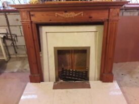 Wooden ornate fireplace with marble hearth and surround