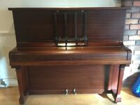 Iron frame, British built, mahogany Kemble upright piano