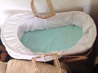 Moses basket and stand with mattress and 7 matress sheets ( 5 x unused, 2 x used)